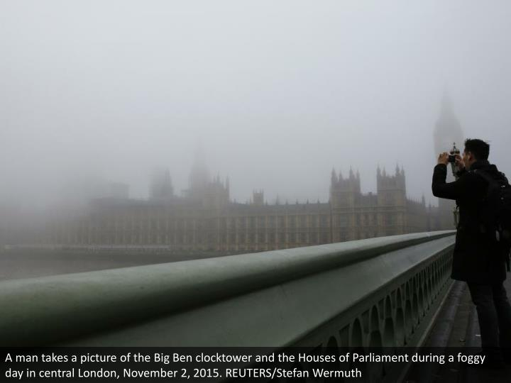A man takes a picture of the Big Ben clocktower and the Houses of Parliament during a foggy day in central London, November 2, 2015. REUTERS/Stefan Wermuth