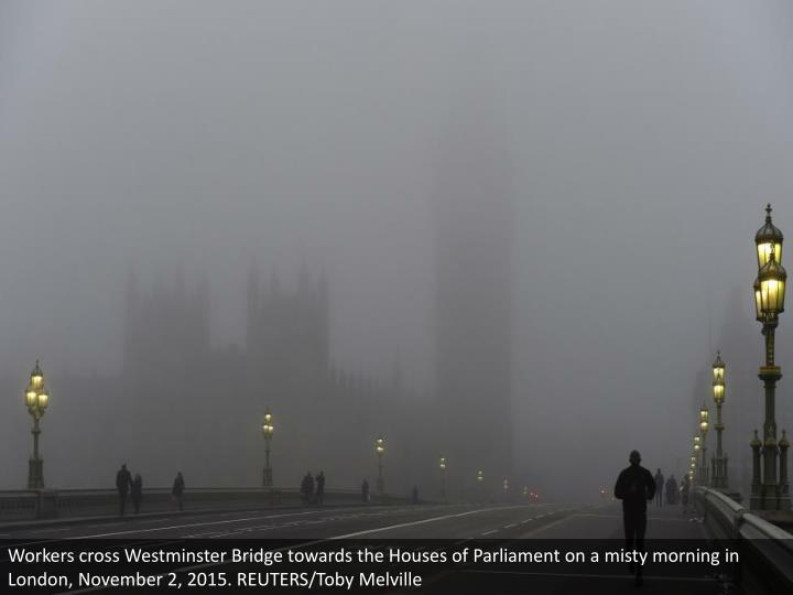 Workers cross Westminster Bridge towards the Houses of Parliament on a misty morning in London, November 2, 2015. REUTERS/Toby Melville