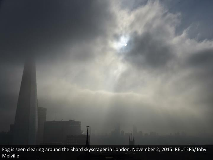 Fog is seen clearing around the Shard skyscraper in London, November 2, 2015. REUTERS/Toby Melville