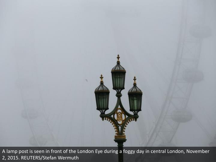 A lamp post is seen in front of the London Eye during a foggy day in central London, November 2, 2015. REUTERS/Stefan Wermuth