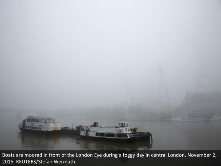 Boats are moored in front of the London Eye during a foggy day in central London, November 2, 2015. REUTERS/Stefan Wermuth