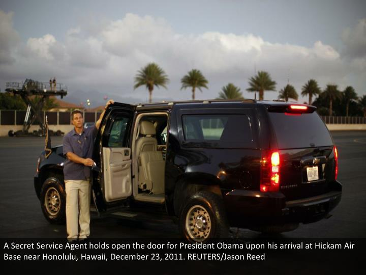 A Secret Service Agent holds open the door for President Obama upon his arrival at Hickam Air Base near Honolulu, Hawaii, December 23, 2011. REUTERS/Jason Reed