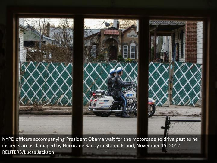 NYPD officers accompanying President Obama wait for the motorcade to drive past as he inspects areas damaged by Hurricane Sandy in Staten Island, November 15, 2012. REUTERS/Lucas Jackson