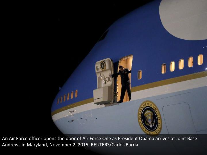 An Air Force officer opens the door of Air Force One as President Obama arrives at Joint Base Andrew...