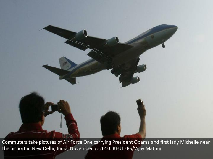 Commuters take pictures of Air Force One carrying President Obama and first lady Michelle near the airport in New Delhi, India, November 7, 2010. REUTERS/Vijay Mathur