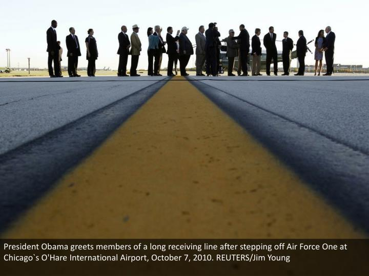 President Obama greets members of a long receiving line after stepping off Air Force One at Chicago`s O'Hare International Airport, October 7, 2010. REUTERS/Jim Young