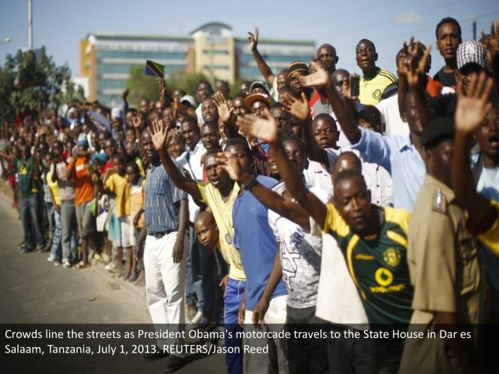 Crowds line the streets as President Obama's motorcade travels to the State House in Dar es Salaam, Tanzania, July 1, 2013. REUTERS/Jason Reed