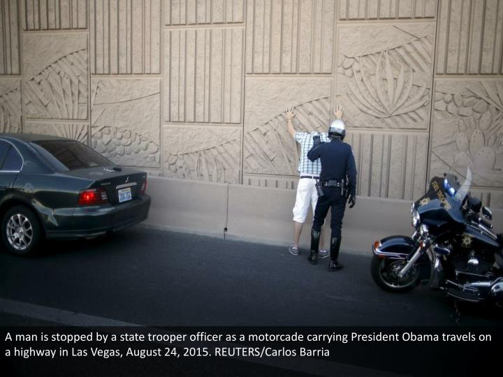 A man is stopped by a state trooper officer as a motorcade carrying President Obama travels on a highway in Las Vegas, August 24, 2015. REUTERS/Carlos Barria