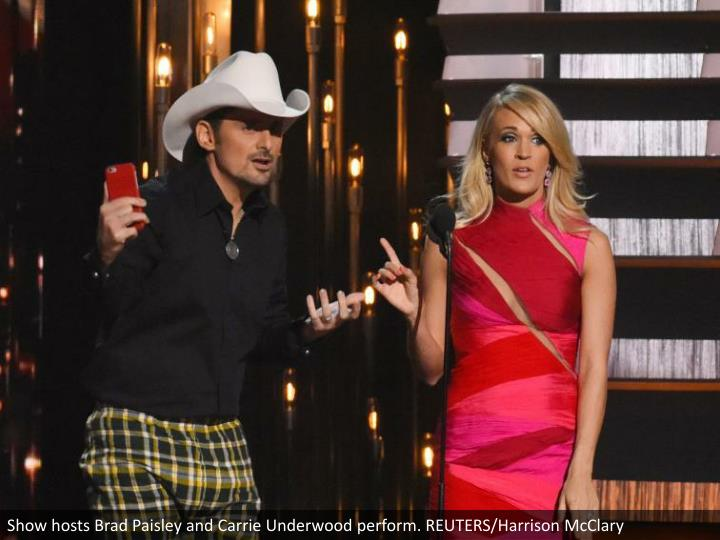 Show hosts Brad Paisley and Carrie Underwood perform. REUTERS/Harrison McClary
