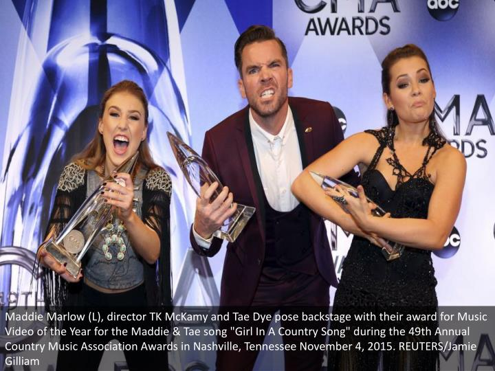 "Maddie Marlow (L), director TK McKamy and Tae Dye pose backstage with their award for Music Video of the Year for the Maddie & Tae song ""Girl In A Country Song"" during the 49th Annual Country Music Association Awards in Nashville, Tennessee November 4, 2015. REUTERS/Jamie Gilliam"