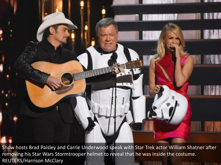 Show hosts Brad Paisley and Carrie Underwood speak with Star Trek actor William Shatner after removing his Star Wars Stormtrooper helmet to reveal that he was inside the costume. REUTERS/Harrison McClary