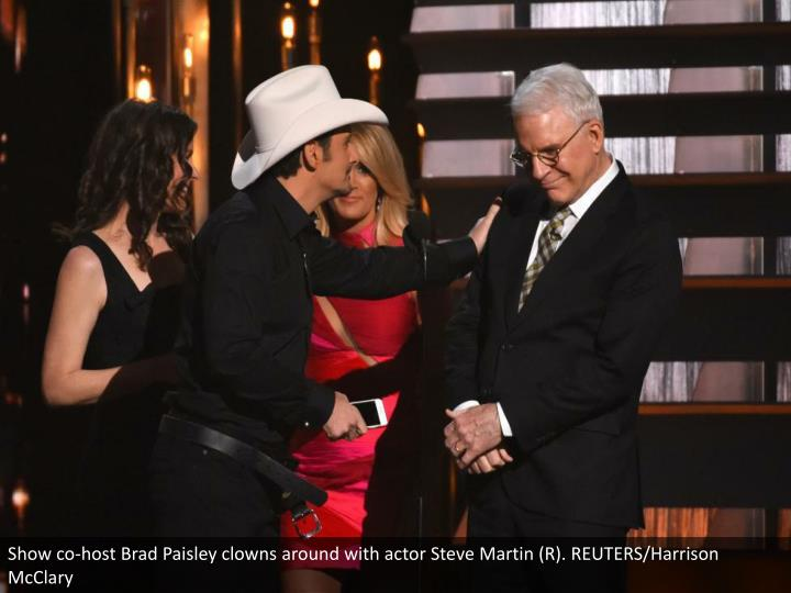 Show co-host Brad Paisley clowns around with actor Steve Martin (R). REUTERS/Harrison McClary