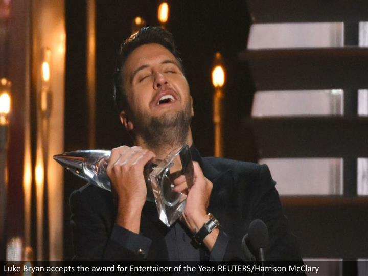 Luke Bryan accepts the award for Entertainer of the Year. REUTERS/Harrison McClary