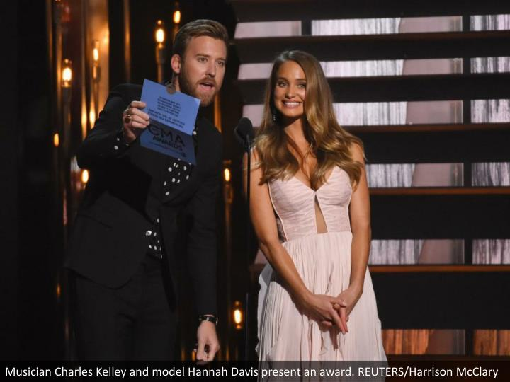 Musician Charles Kelley and model Hannah Davis present an award. REUTERS/Harrison McClary