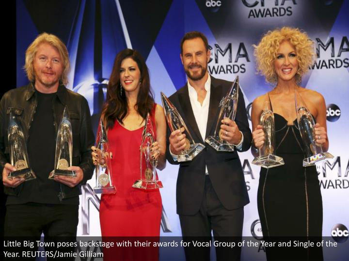 Little Big Town poses backstage with their awards for Vocal Group of the Year and Single of the Year. REUTERS/Jamie Gilliam