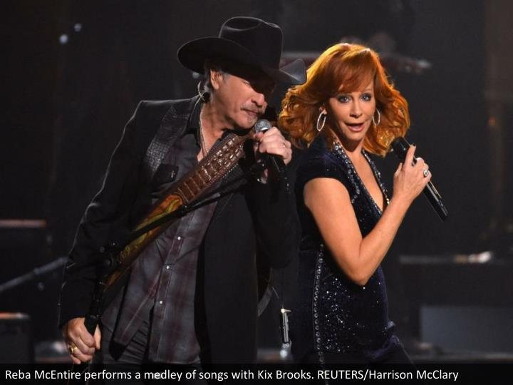Reba McEntire performs a medley of songs with Kix Brooks. REUTERS/Harrison McClary