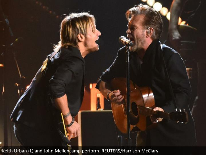 Keith Urban (L) and John Mellencamp perform. REUTERS/Harrison McClary