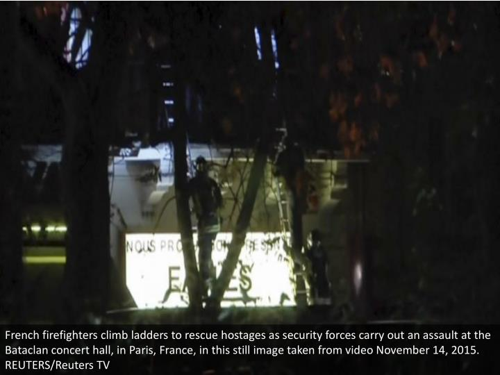 French firefighters climb ladders to rescue hostages as security forces carry out an assault at the Bataclan concert hall, in Paris, France, in this still image taken from video November 14, 2015. REUTERS/Reuters TV