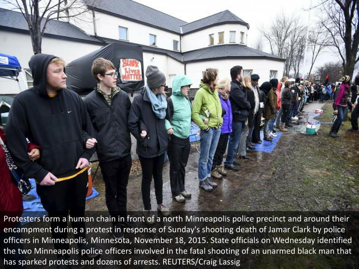 Protesters form a human chain in front of a north Minneapolis police precinct and around their encam...