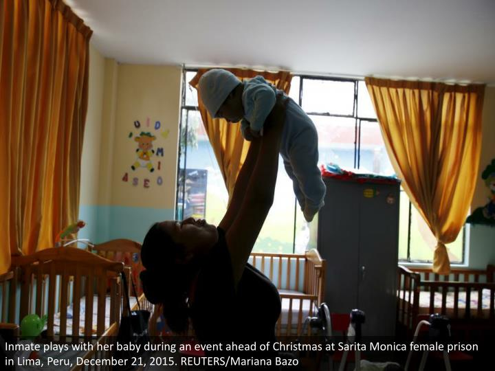 Inmate plays with her baby during an event ahead of Christmas at Sarita Monica female prison in Lima, Peru, December 21, 2015. REUTERS/Mariana Bazo
