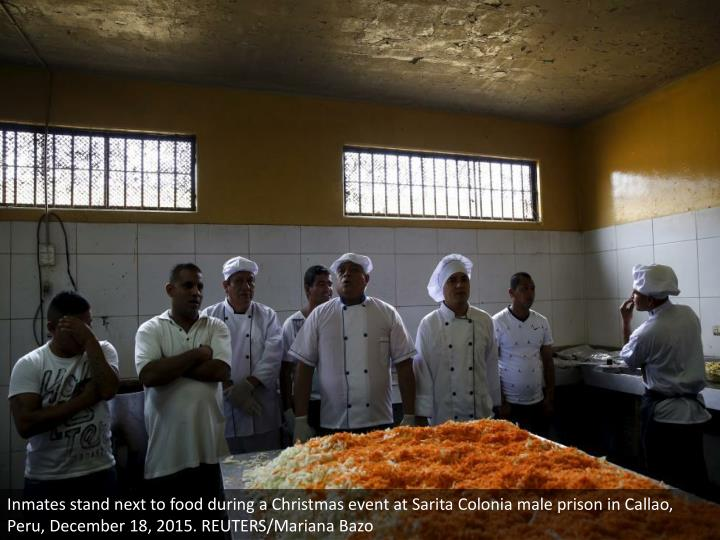 Inmates stand next to food during a Christmas event at Sarita Colonia male prison in Callao, Peru, December 18, 2015. REUTERS/Mariana Bazo
