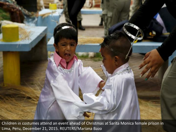 Children in costumes attend an event ahead of Christmas at Sarita Monica female prison in Lima, Peru, December 21, 2015. REUTERS/Mariana Bazo