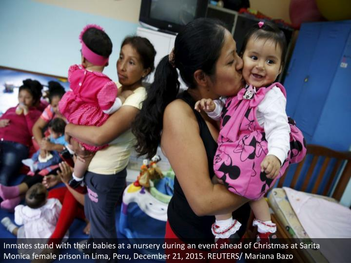 Inmates stand with their babies at a nursery during an event ahead of Christmas at Sarita Monica female prison in Lima, Peru, December 21, 2015. REUTERS/ Mariana Bazo