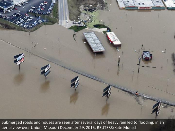 Submerged roads and houses are seen after several days of heavy rain led to flooding, in an aerial v...