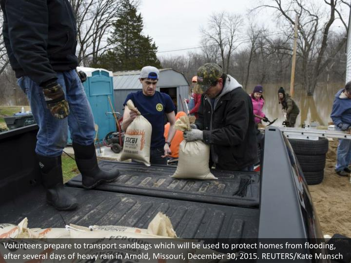 Volunteers prepare to transport sandbags which will be used to protect homes from flooding, after several days of heavy rain in Arnold, Missouri, December 30, 2015. REUTERS/Kate Munsch