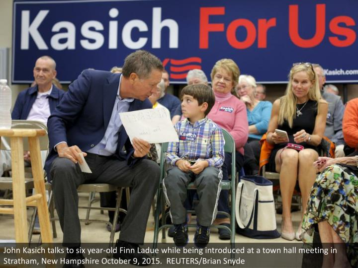John Kasich talks to six year-old Finn Ladue while being introduced at a town hall meeting in Stratham, New Hampshire October 9, 2015.  REUTERS/Brian Snyde