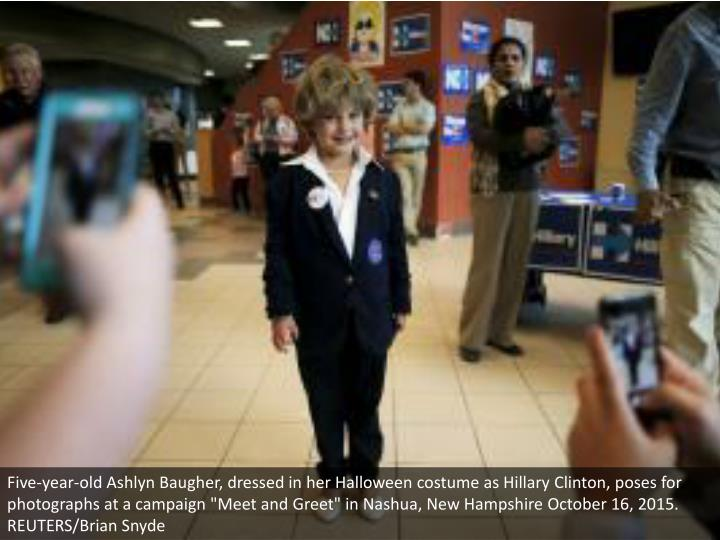 Five-year-old Ashlyn Baugher, dressed in her Halloween costume as Hillary Clinton, poses for photogr...