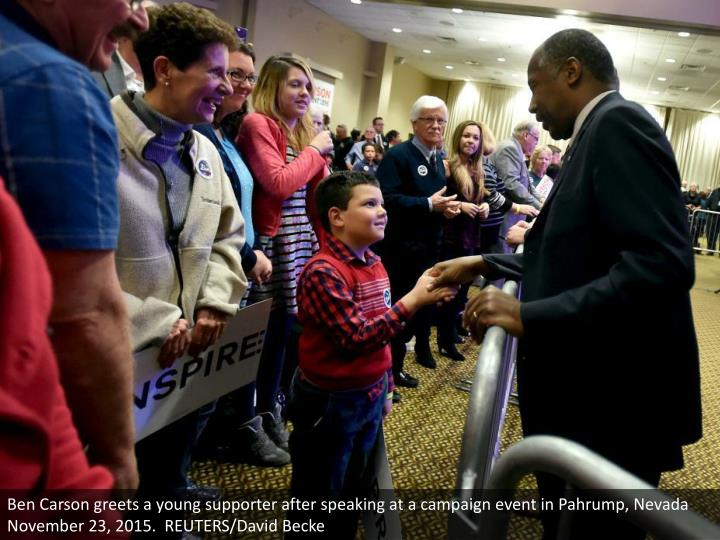 Ben Carson greets a young supporter after speaking at a campaign event in Pahrump, Nevada November 23, 2015.  REUTERS/David Becke