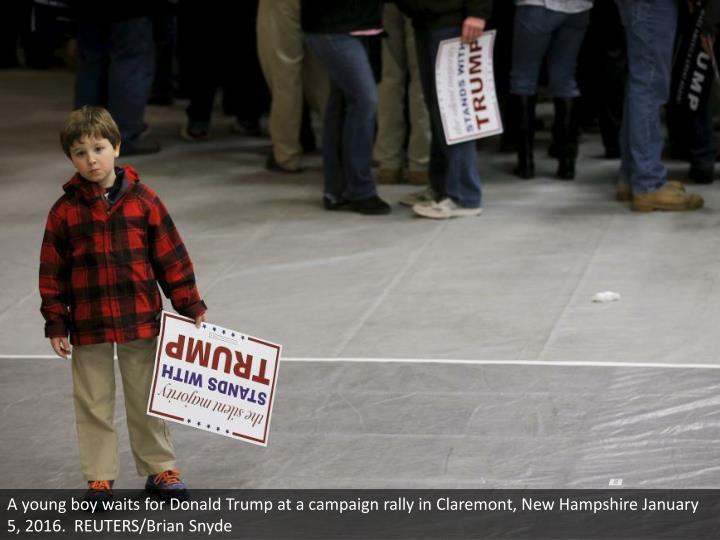 A young boy waits for Donald Trump at a campaign rally in Claremont, New Hampshire January 5, 2016.  REUTERS/Brian Snyde