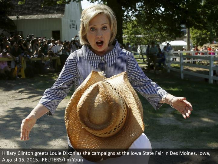 Hillary Clinton greets Louie Dixon as she campaigns at the Iowa State Fair in Des Moines, Iowa, August 15, 2015.  REUTERS/Jim Youn