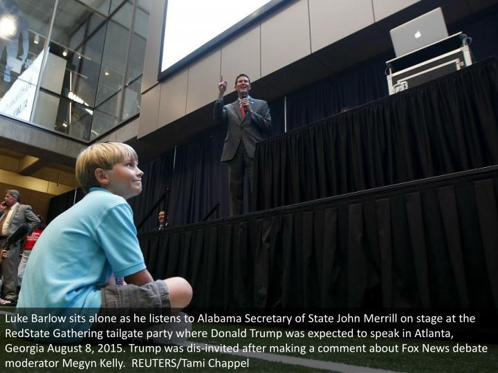 Luke Barlow sits alone as he listens to Alabama Secretary of State John Merrill on stage at the RedState Gathering tailgate party where Donald Trump was expected to speak in Atlanta, Georgia August 8, 2015. Trump was dis-invited after making a comment about Fox News debate moderator Megyn Kelly.  REUTERS/Tami Chappel