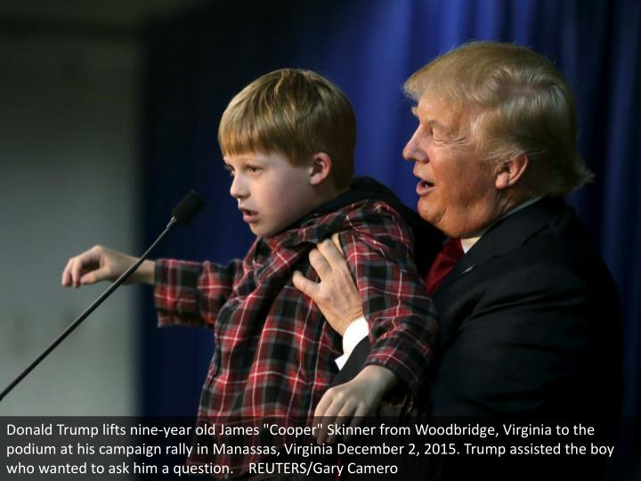 "Donald Trump lifts nine-year old James ""Cooper"" Skinner from Woodbridge, Virginia to the podium at his campaign rally in Manassas, Virginia December 2, 2015. Trump assisted the boy who wanted to ask him a question.    REUTERS/Gary Camero"