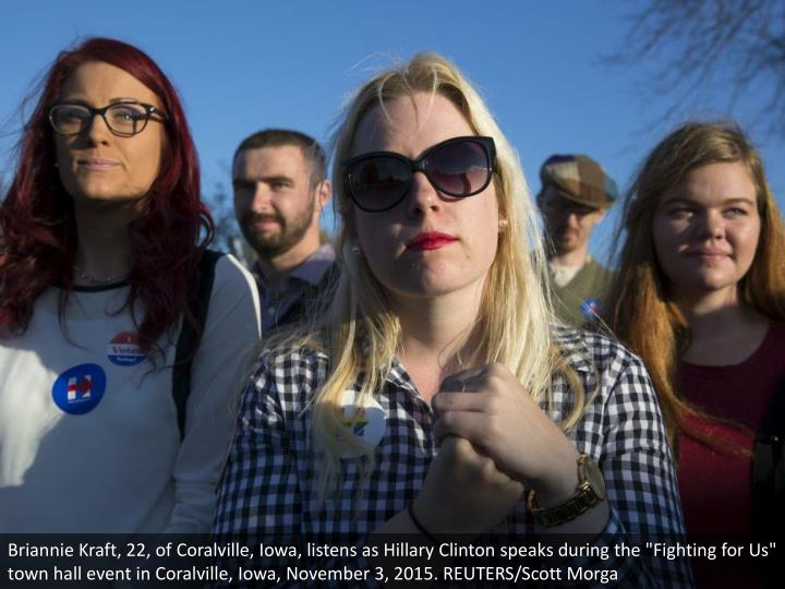 "Briannie Kraft, 22, of Coralville, Iowa, listens as Hillary Clinton speaks during the ""Fighting for Us"" town hall event in Coralville, Iowa, November 3, 2015. REUTERS/Scott Morga"