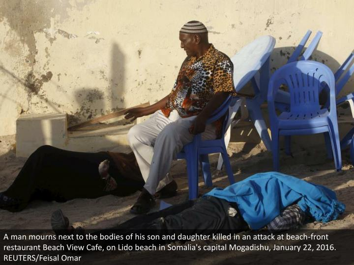 A man mourns next to the bodies of his son and daughter killed in an attack at beach-front restaurant Beach View Cafe, on Lido beach in Somalia's capital Mogadishu, January 22, 2016. REUTERS/Feisal Omar
