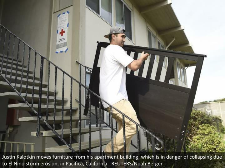 Justin Kalotkin moves furniture from his apartment building, which is in danger of collapsing due to El Nino storm erosion, in Pacifica, California.  REUTERS/Noah Berger