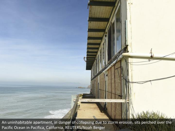 An uninhabitable apartment, in danger of collapsing due to storm erosion, sits perched over the Pacific Ocean in Pacifica, California. REUTERS/Noah Berger