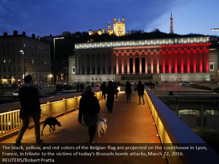 The black, yellow, and red colors of the Belgian flag are projected on the courthouse in Lyon, France, in tribute to the victims of today's Brussels bomb attacks, March 22, 2016. REUTERS/Robert Pratta
