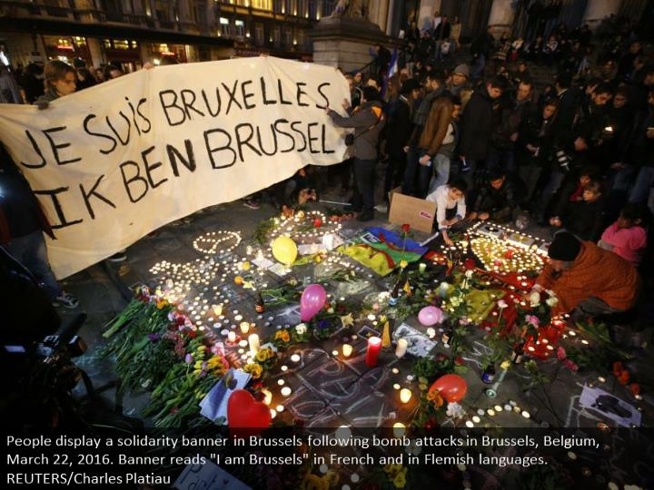 People display a solidarity banner in Brussels following bomb attacks in Brussels, Belgium, March 22...