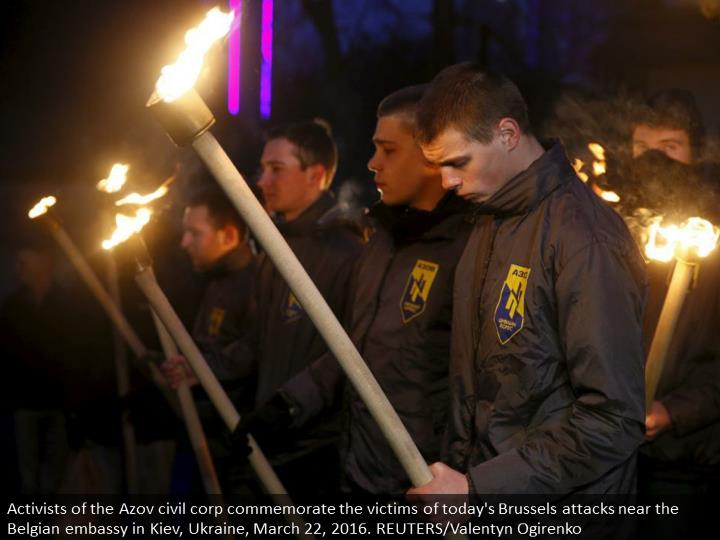Activists of the Azov civil corp commemorate the victims of today's Brussels attacks near the Belgian embassy in Kiev, Ukraine, March 22, 2016. REUTERS/Valentyn Ogirenko