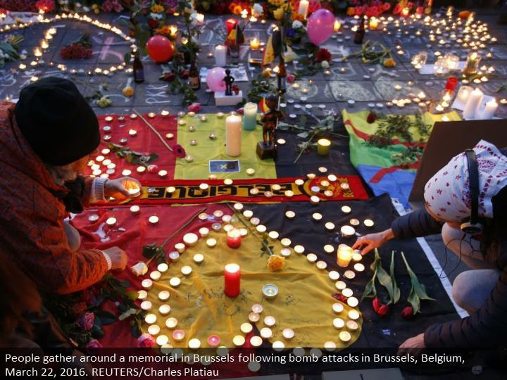 People gather around a memorial in Brussels following bomb attacks in Brussels, Belgium, March 22, 2016. REUTERS/Charles Platiau