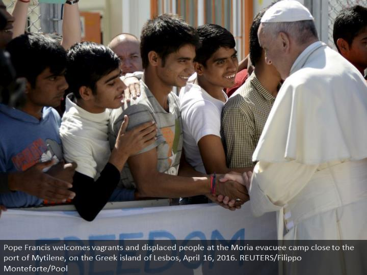 Pope Francis greets migrants and refugees at the Moria refugee camp near the port of Mytilene, on the Greek island of Lesbos, April 16, 2016. REUTERS/Filippo Monteforte/Pool
