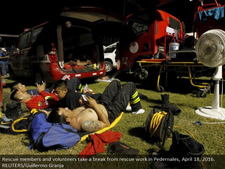 Rescue members and volunteers take a break from rescue work in Pedernales, April 18, 2016. REUTERS/Guillermo Granja