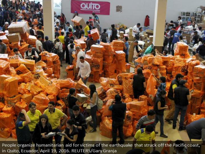 People organize humanitarian aid for victims of the earthquake that struck off the Pacific coast, in Quito, Ecuador, April 19, 2016. REUTERS/Gary Granja