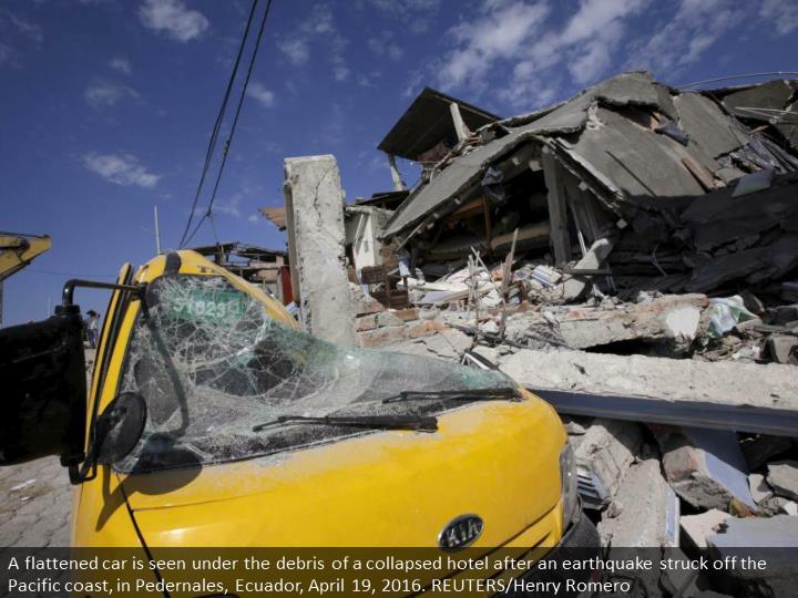 A flattened car is seen under the debris of a collapsed hotel after an earthquake struck off the Pacific coast, in Pedernales, Ecuador, April 19, 2016. REUTERS/Henry Romero