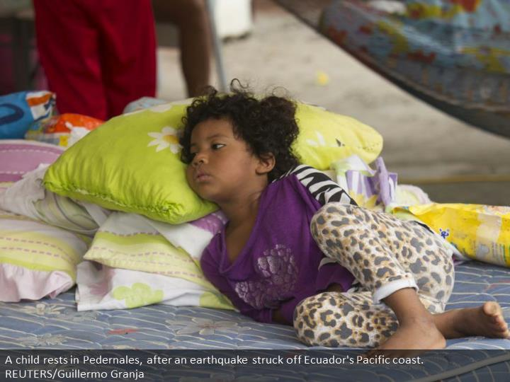 A child rests in Pedernales, after an earthquake struck off Ecuador's Pacific coast. REUTERS/Guillermo Granja