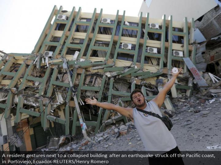 A resident gestures next to a collapsed building after an earthquake struck off the Pacific coast, in Portoviejo, Ecuador. REUTERS/Henry Romero
